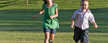 Happy kids running in the park