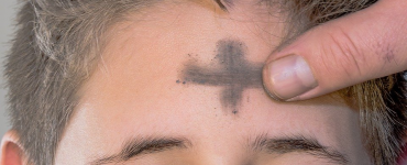 Ashes applied to the forehead.