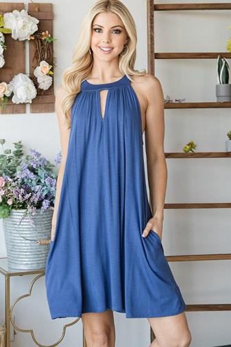 A woman wearing a blue summer dress.
