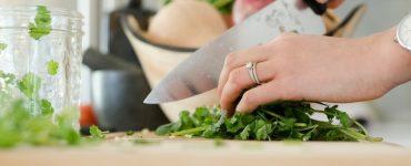 Woman cutting organic mint leaves