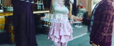corporate event entertainment performers serving drinks
