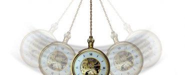 A pendulum swinging back and forth.