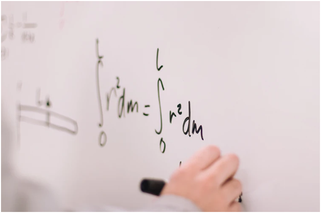 Advanced mathematical concepts on a whiteboard