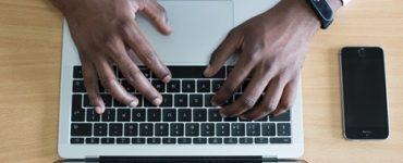 Two friends enrolling in an online professional development course