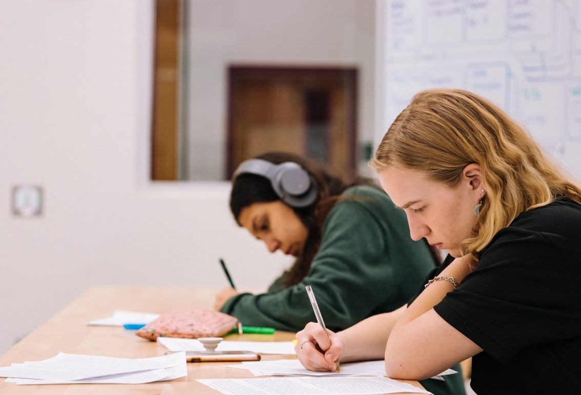 Students taking an exam for a registered nurse in Canada