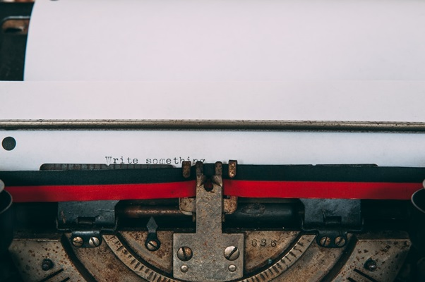 Closeup of a Typewriter Page with 'Write Something' Typed on it