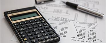 A calculator and pen on an exam sheet
