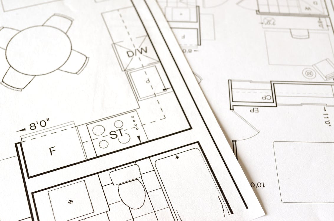 A detailed floor plan on a piece of paper