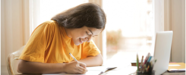 Girl smiling while studying online