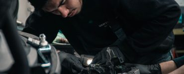 a technician tuning the engine