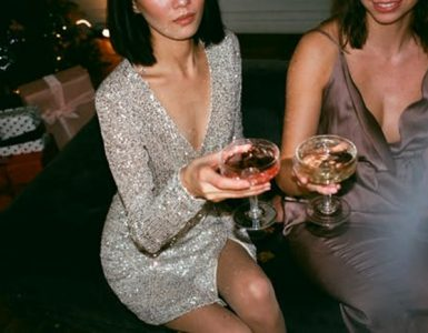 two women in cocktail dresses at a party
