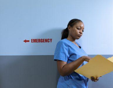 A nurse holding a yellow file